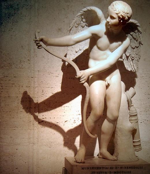 A classic Greek statue of Cupid