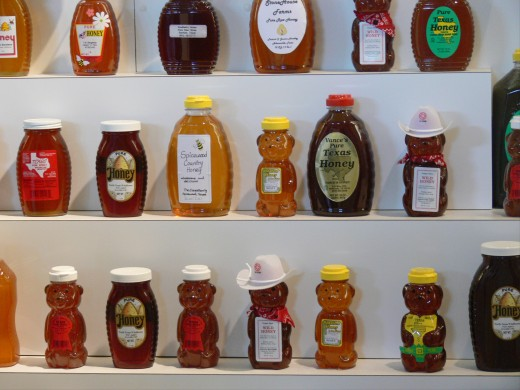 Different brands of honey at the Texas State Fair.