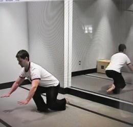 Airplane/Free Leg Behind Squat-Screen shot of Bodyweight Exercise Revolution's Adam Steer.