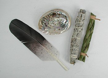 Smudging is a Native American ceremonial art done to banish negative energy. A shell, a feather, and a stick of white sage.