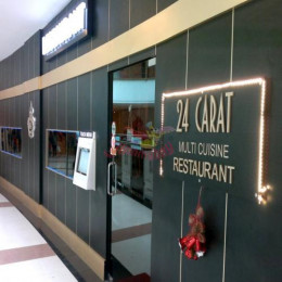 @24 Carat  -The big name plate that read 24 Carat – Multi cuisine restaurant, in a very different font