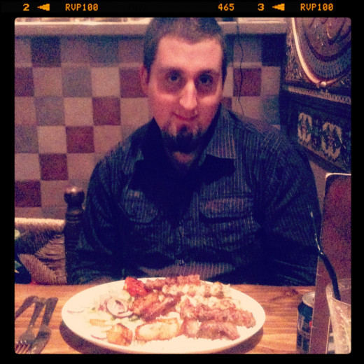 My hubby Jon with his mixed grill meal, he didn't want the photo taken, hence the silly face. Can Zaman