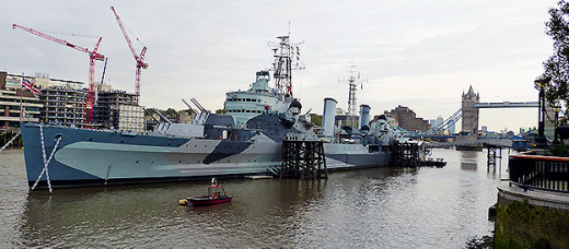 HMS Belfast moored just below London's iconic Tower Bridge which can be seen in the background
