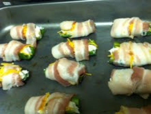Wrap 1/2 slice of bacon around each stuffed pepper.  (can secure with tooth picks if needed)