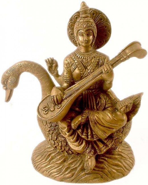 Saraswati is Goddess of knowledge , music and arts . She is the companion of Brahma and  It was with her knowledge, that Brahma created the universe . She possesses four arms, wears a  white saree and seated on a white swan .