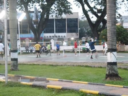 People, even elder ones, playing 'Kenchi Kicking'