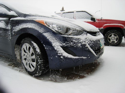 Driving through the snow - sand-laden roads help traction and avoid accidents - result:  muck-filled wheel wells!