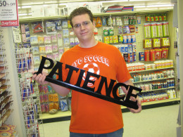 Man holding patience sign.