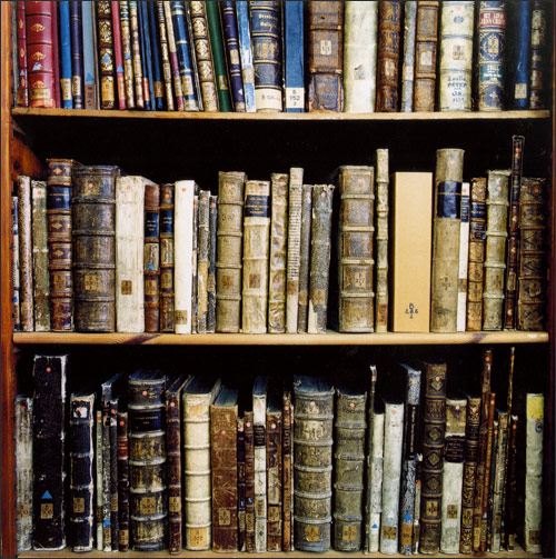 What a lovely looking collection of books. They are so easy to store on shelves! Here are a whole bunch, neatly held on a bookshelf with great care.