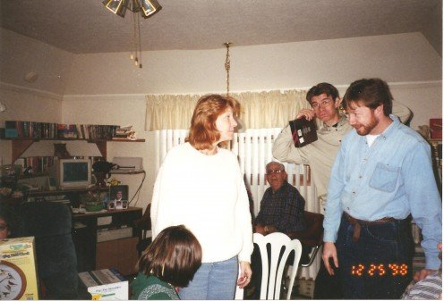 Jan having a bit of fun on Christmas Day, standing behind Tony and his sister, Kathy.