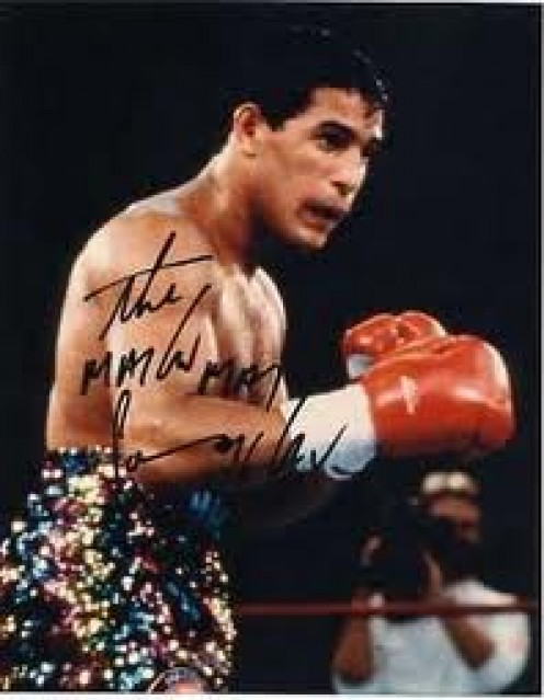 """Hector """"Macho"""" Camacho wore some wild clothes to the boxing ring. Macho Time was  constantly chanted by his supporters. He had fast feet in the ring and was hard to hit with more than one shot at a time."""