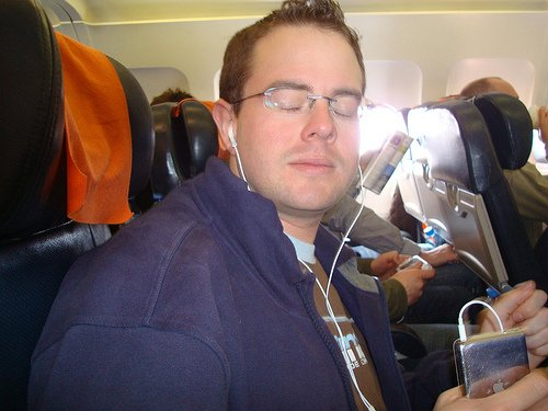 Listening to music or a relaxation download on mp3 is good for flights