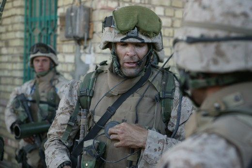 Capt. Doug Zembiec, the commanding officer of Company E, 2nd Battalion, 1st Marine Regiment, 1st Marine Division, gives orders to his men over a radio prior to leaving their secured compound for a short patrol in Fallujah, Iraq April 8, 2004.