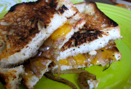Grilled cheese with caramelized onion and cheddar.