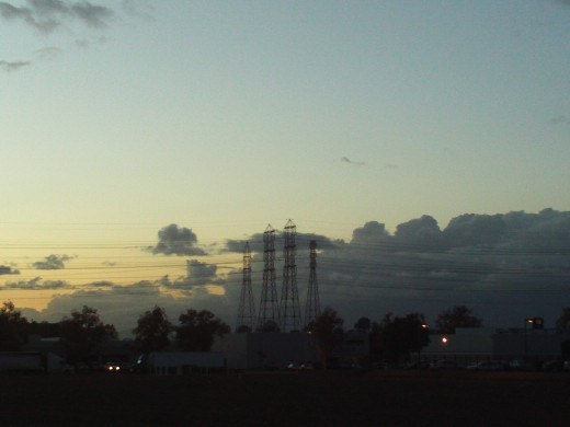 Pylons and clouds in the distance.