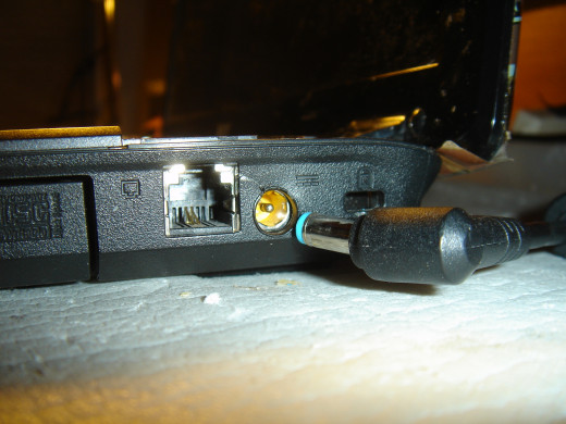 A crack near the power jack. The connector is tilted sideway. When it is turned with the wire to the rear, power is off.