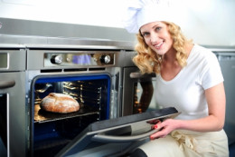 female Baker With Oven