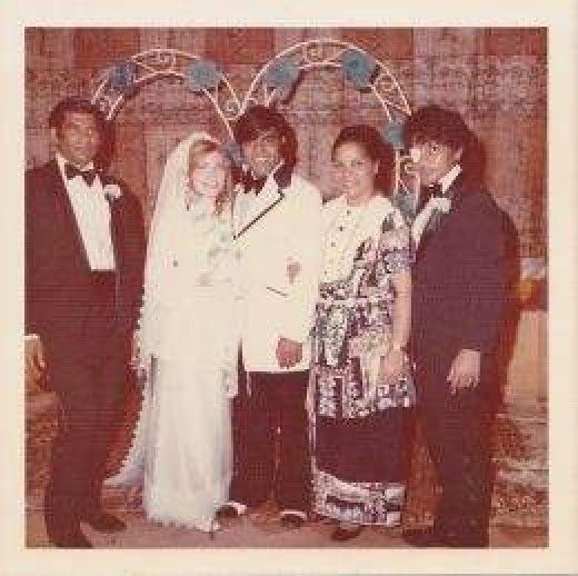 Our Wedding picture with my husband's two brothers and sister at the reception.