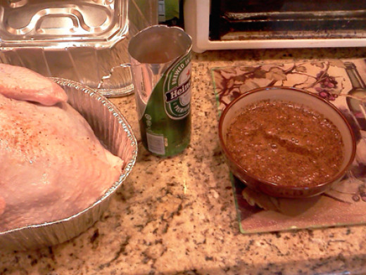 Beer Can Smoked Turkey preparation with beer and spices for basting.
