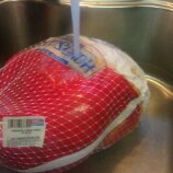 If your turkey is still partially frozen, bath it in cool water for the day. This one I did last year, the center of it was frozen, but perfect after it thawed half the day.