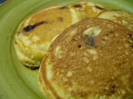 With these gluten-free pancakes, you can mix in whatever you want.  This is a plate of chocolate chip pancakes.