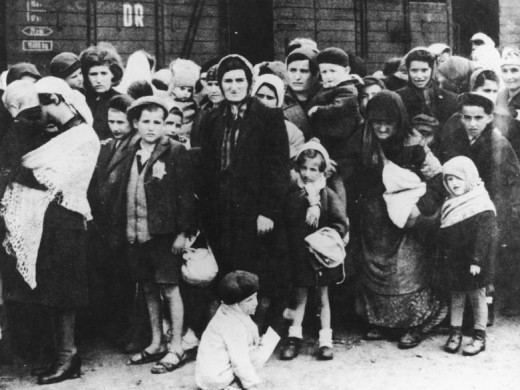 """Hungarian Jewish mothers, children, elderly and infirm were sent to the """"left"""" after selection; here they are waiting in line and will soon be murdered in the gas chambers (May 1944)"""