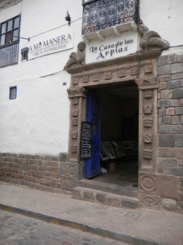When you see the blue doorway this is your entrance through to the bakery. The entrance is decked with peruvian paintings
