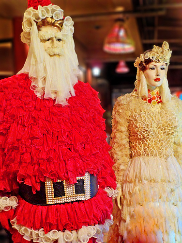 Ho! Ho! Ho!  Santa and Mrs. Claus all decked out in prophylactic rubbers to welcome guests!
