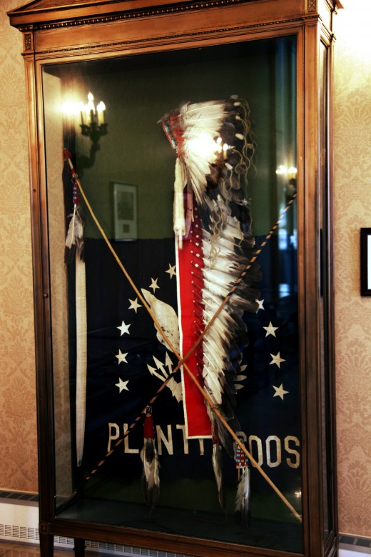 A Crow war bonnet and coup sticks given to the WWI Unknown Soldier. To put a notch in their sticks, a warrior must touch an enemy or their weapons, or strike them with the stick itself and escape unscathed.