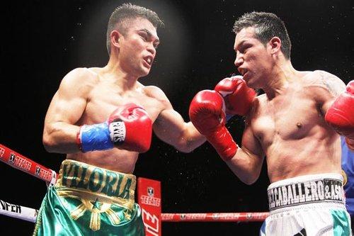 Viloria (L) defeats Marquez
