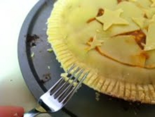Use a fork to crimp the edges of the top crust and the bottom crust together.