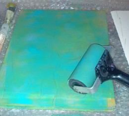 Spreading paint with a brayer.