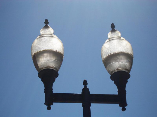 These acorn street light fixtures illuminate more sky than ground, wasting energy and contributing to light pollution.