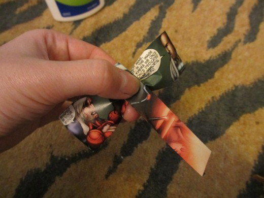 Wrap the smaller rectangular bit around the center and glue the edge down in the back of your bow.