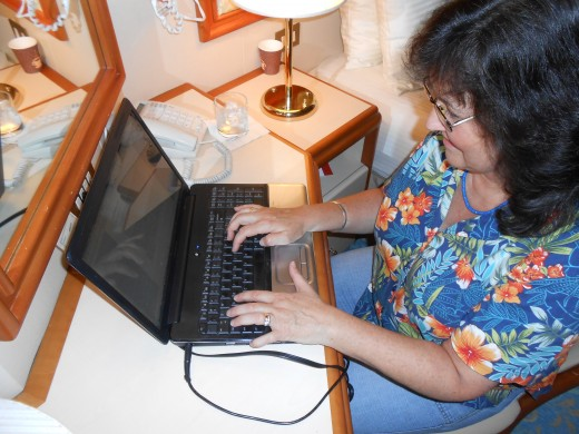 The author, taking a break from cruising fun to work on a hub in my stateroom! This was on the cruise to Hawaii... notice the shirt!