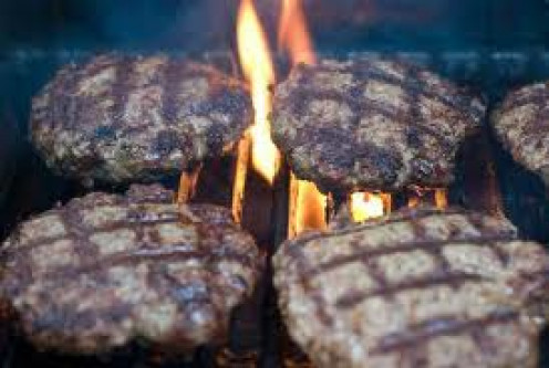 Grill out food such as these hamburgers to entertain your company while watching the big  game. Some wings and chips and dip are another good snack food for guests during the big game.