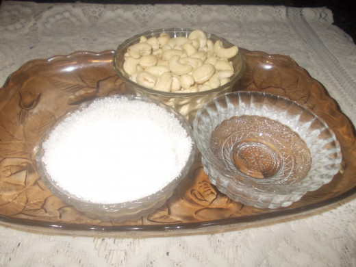 The three ingredients needed for Cashew nut  peda (Cashew nuts,.Sugar,and Water,)