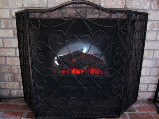 Placing a beautiful fireplace screen in front of the opening, gives the appearance of a real fire.