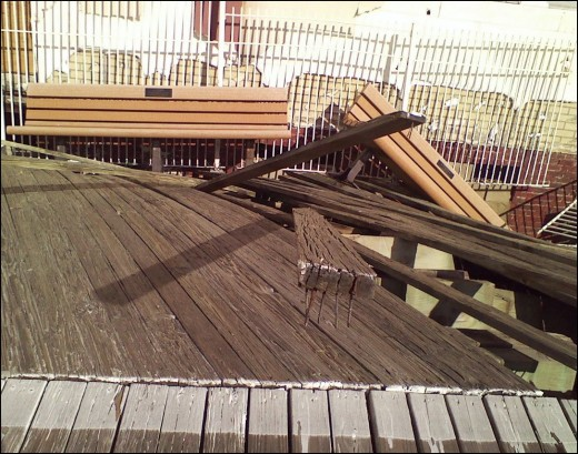 Memorial benches sinking into wrecked boardwalk