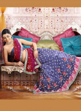 Moti Essence Purple And Red Net Lehenga Choli. Photo courtesy of Cbazaar.com.