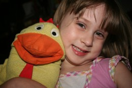 My daughter and the chicken puppet she received as a PST birthday party favor.