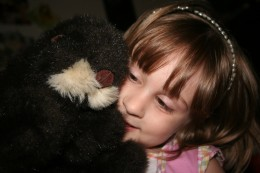 My daughter playing with an otter puppet given to me  by one of my aunts.