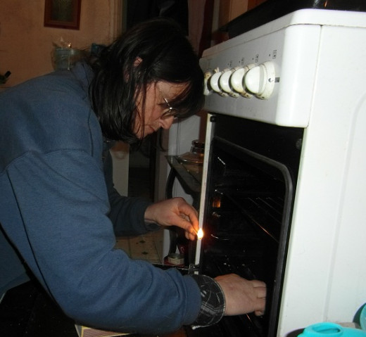 Lighting the oven - head and both hands required