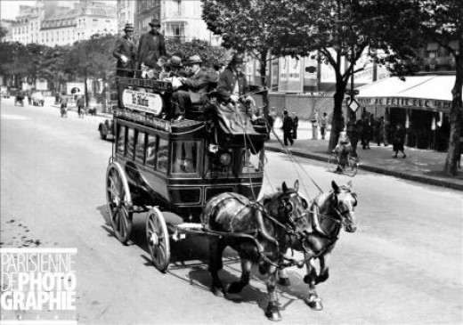 Paris 1942. Double decker horsedrawn carriage put back in service for public transportation. Copyright LAPI/Roger-Viollet