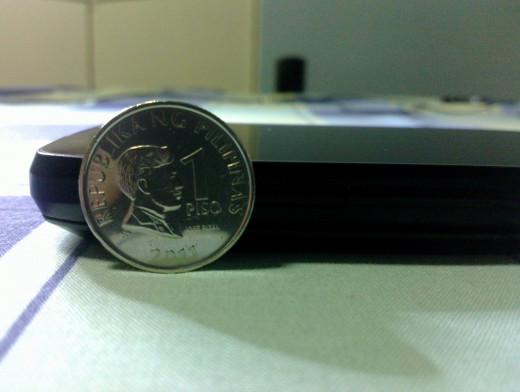 1 Peso coin (24 mm) vs Thrill 430x (14.2 mm)