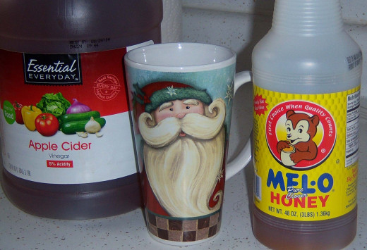 Apple cider vinegar, honey and an appropriate mug for the season. Santa heals through bringing good will and goodies, right?