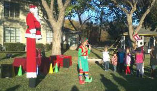 Santa on stilts plays reindeer games with children.
