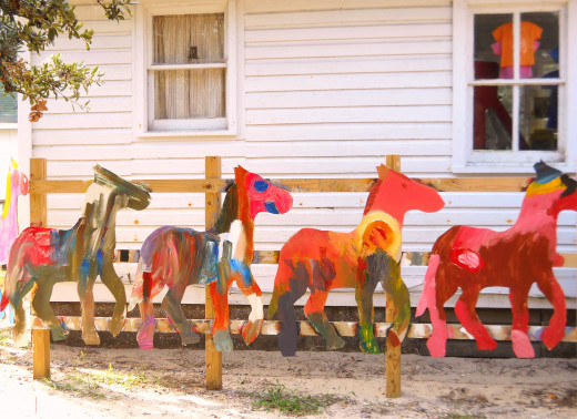 Children painted these colorful horses as a tribute to the Wild Horses of Corolla. The nonprofit Wild Horse Fund sells them as a fundraiser.