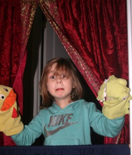 Our daughter presenting a puppet show for her Papa in our new home. Because of the PST, she has developed a lifelong love of puppetry.
