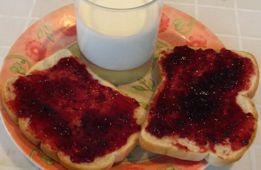 Toasted bread, butter and jam, or fruit spread.